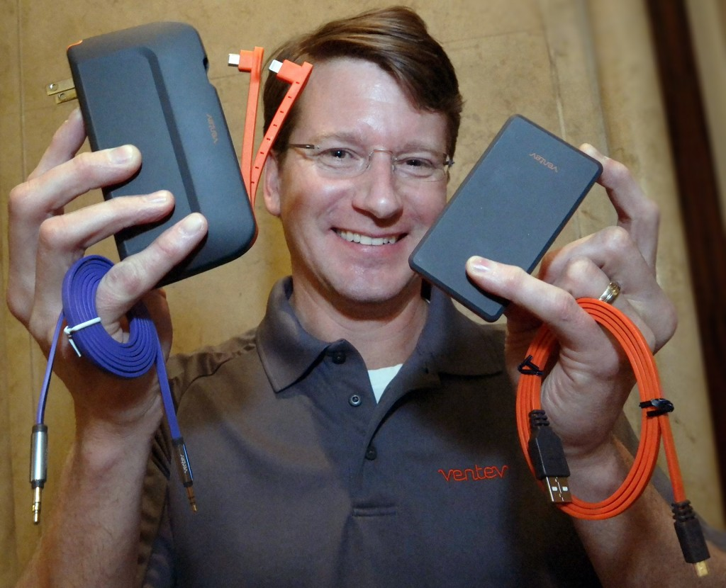 Ventev Mobile Director of Marketing Scott Franklin shows quality mobile accessories including the new  Powercell 10000+ direct wall charger-battery left, that charges three devices at the same time