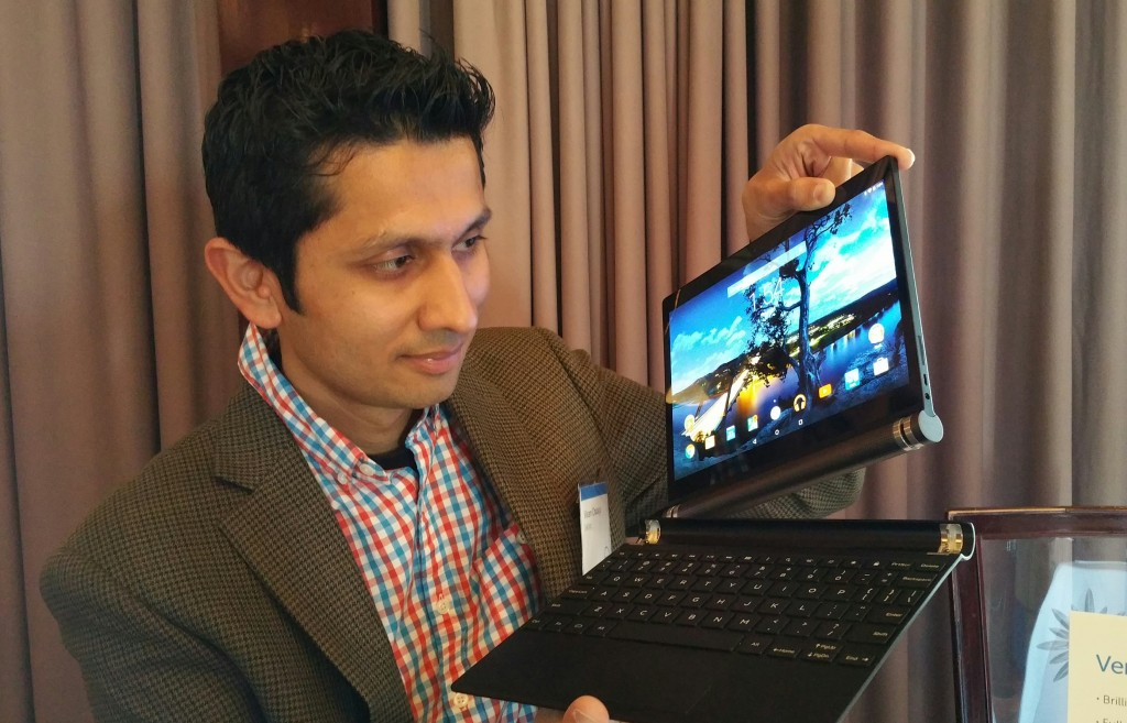 Dell's Vikram Chadaga with the new Dell Venue 10 7000 Android Tablet with magnetically detachable baklit keyboard.