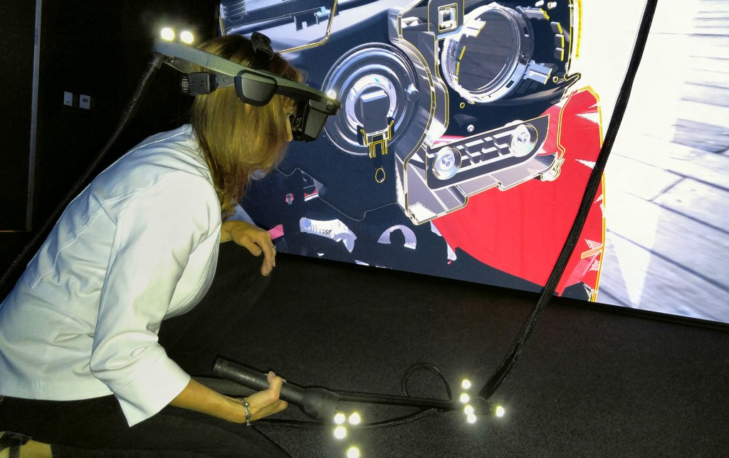 Elizabeth Baron uses Virtual Reality headgear to probe layers of a car that isn't there at the Ford Silicon Valley Research and Innovation Centre in Palo Alto